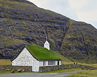 Saksun Church. Saksun is a village near the northwest coast of the Faroese island of Streymoy, in Sunda Municipality. Saksun lies in the bottom of what used to be an inlet of the sea, surrounded by high mountains.
