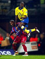 Fotball<br /> Premier League 2004/2005<br /> 06.11.2004<br /> Foto: BPI/Digitalsport<br /> NORWAY ONLY<br /> <br /> Crystal Palace v Arsenal<br /> <br /> Lauren of Arsenal jumps higher than Wayne Routledge