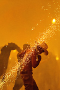 A Mexican cowboy has a sky rocket skid across his naked back as he dances in the chaos of the Alborada festival September 29, 2018 in San Miguel de Allende, Mexico. The unusual festival celebrates the cities patron saint with a two hour-long firework battle at 4am representing the struggle between Saint Michael and Lucifer.