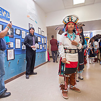 052413       Cable Hoover<br /> <br /> Zuni Middle School sixth-grader Loren Quam, center, and his classmates line to perform traditional turkey and deer dances during the Zuni Middle School art show in Zuni Friday.