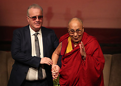 Children in Crossfire CEO Richard Moore alongside the Dalai Lama at the Millennium Forum, during a visit to Londonderry.