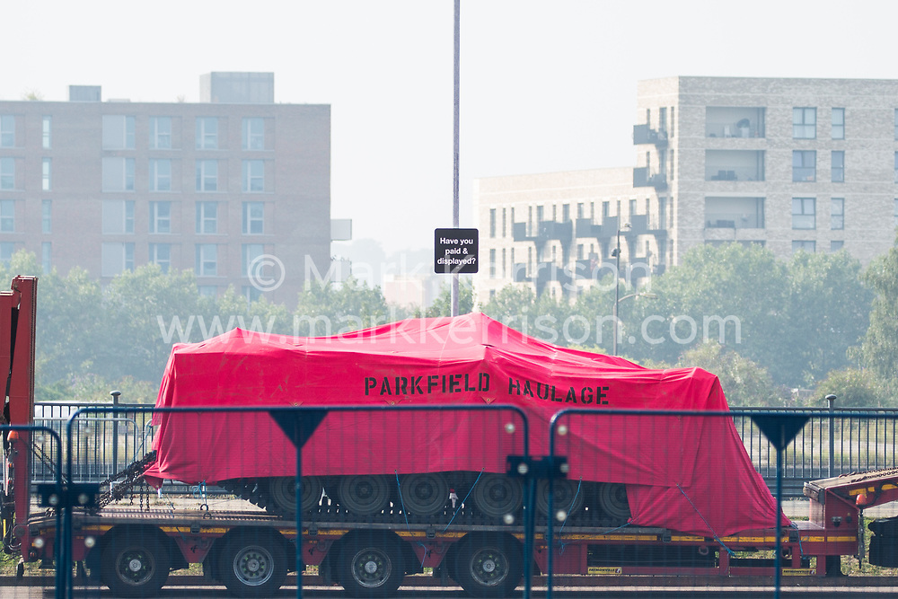London, UK. 6th September, 2021. A military vehicle is pictured on a trailer in a holding area outside ExCeL London as preparations are made for the DSEI 2021 arms fair. The first day of week-long Stop The Arms Fair protests outside the venue for one of the world's largest arms fairs was hosted by activists calling for a ban on UK arms exports to Israel.