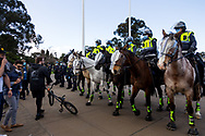 MELBOURNE, VIC - SEPTEMBER 05: Mounted police move on protesters during the Anti-Lockdown Protest on September 05, 2020 in Sydney, Australia. Stage 4 restrictions are in place from 6pm on Sunday 2 August for metropolitan Melbourne. This includes a curfew from 8pm to 5am every evening. During this time people are only allowed to leave their house for work, and essential health, care or safety reasons. (Photo by Dave Hewison/Speed Media)