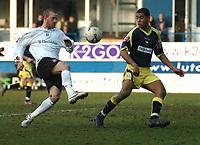Photo: Ian Hebden.<br /> Luton Town v Derby County. Coca Cola Championship. 18/03/2006.<br /> Luton's Rowan Vine (L) chips the ball over Derby's Lewin Nyatanga (R).