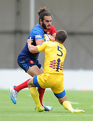 Jonathan Laugel of France is challenged by Alexandru Ionut Tigla of Romania - Photo mandatory by-line: Dougie Allward/JMP - Mobile: 07966 386802 - 11/07/2015 - SPORT - Rugby - Exeter - Sandy Park - European Grand Prix 7s