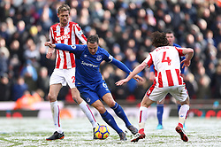 Everton's Phil Jagielka (centre) battles for the ball with Stoke City's Joe Allen (right) and Peter Crouch