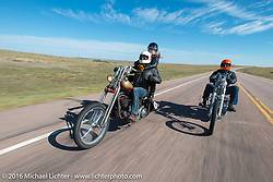 Sean Duggan (L) riding his 1936 Harley-Davidson Knucklehead chopper with good friend and riding partner Bill Buckingham on his 1936 Harley-Davidson Knucklehead custom chopper (that won top honors at Born Free 6) during Stage 9 (249 miles) of the Motorcycle Cannonball Cross-Country Endurance Run, which on this day ran from Burlington to Golden, CO., USA. Sunday, September 14, 2014.  Photography ©2014 Michael Lichter.