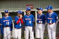 Laconia Rotary majors Kyle Harding, Jacob Hebert, Tim Ausevich, Kurtis Jobin and Jack Higgins stand along the first base line during opening day ceremonies for Laconia Little League Saturday morning on Colby Field.  (Karen Bobotas/for the Laconia Daily Sun)