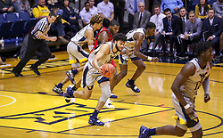 Dec 1, 2018; Morgantown, WV, USA; West Virginia Mountaineers guard Jermaine Haley (10) dribbles up the floor during the first half against the Youngstown State Penguins at WVU Coliseum. Mandatory Credit: Ben Queen-USA TODAY Sports