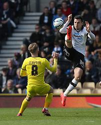 Derby County's George Thorne battles with Huddersfield's Adam Clayton - Photo mandatory by-line: Matt Bunn/JMP - Tel: Mobile: 07966 386802 -12/04/2014 - SPORT - FOOTBALL - IPRO Stadium- Derby - Derby County v Huddersfield- Sky Bet Championship