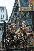 Constructing scaffolding out of bamboo poles. Kowloon, Hong Kong, China