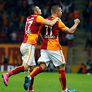 Galatasaray's Burak Yilmaz (L) and Lukas Podolski (R) during their Turkish Super League soccer match Galatasaray between Mersin idman Yurdu at the AliSamiYen Spor Kompleksi TT Arena at Seyrantepe in Istanbul Turkey on Saturday, 12 September 2015. Photo by Kurtulus YILMAZ/TURKPIX