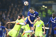 John Terry, the Chelsea captain ©  jumps to head the ball at goal from a corner. The Emirates FA cup, 3rd round match, Chelsea v Peterborough Utd at Stamford Bridge in London on Sunday 8th January 2017.<br /> pic by John Patrick Fletcher, Andrew Orchard sports photography.