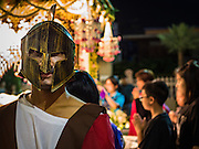 25 MARCH 2016 - BANGKOK, THAILAND: A man dressed as Roman soldier holds back the crowd during Good Friday observances at Santa Cruz Church in Bangkok. Santa Cruz was one of the first Catholic churches established in Bangkok. It was built in the late 1700s by Portuguese soldiers allied with King Taksin the Great in his battles against the Burmese who invaded Thailand (then Siam). There are about 300,000 Catholics in Thailand, in 10 dioceses with 436 parishes. Good Friday marks the day Jesus Christ was crucified by the Romans and is one of the most important days in Catholicism and Christianity.      PHOTO BY JACK KURTZ