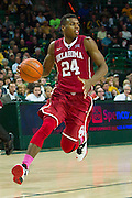 WACO, TX - JANUARY 24: Buddy Hield #24 of the Oklahoma Sooners drives to the basket against the Baylor Bears on January 24, 2015 at the Ferrell Center in Waco, Texas.  (Photo by Cooper Neill/Getty Images) *** Local Caption *** Buddy Hield