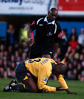 Photo: Ed Godden.<br />Portsmouth v Arsenal. The Barclays Premiership. 12/04/2006. Arsenal's Sol Campbell lies injured.