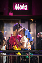 """© Licensed to London News Pictures . 16/11/2015 . Manchester , UK . A couple kiss at the event . Annual student pub crawl """" Carnage """" at Manchester's Deansgate Locks nightclubs venue . The event sees students visit several clubs over the course of an evening . This year's theme is """" Animal Instinct - unleash your beast """" . Photo credit : Joel Goodman/LNP"""