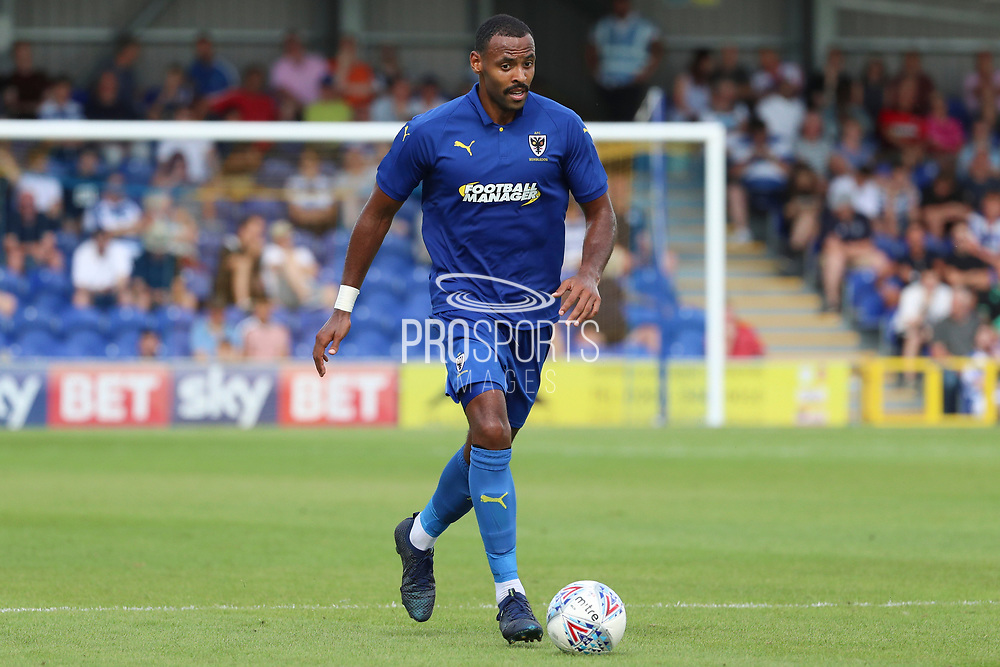 AFC Wimbledon midfielder Liam Trotter (14) dribbling during the Pre-Season Friendly match between AFC Wimbledon and Queens Park Rangers at the Cherry Red Records Stadium, Kingston, England on 14 July 2018. Picture by Matthew Redman.