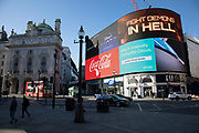 Thought provoking message on the giant advertising boards at Piccadilly Circus almost deserted due to the Covid-19 outbreak and social distancing on what would normally be a busy, bustling day with hoards of people out to shop and socialise on 22nd March 2020 in London, England, United Kingdom. Coronavirus or Covid-19 is a new respiratory illness that has not previously been seen in humans. While much or Europe has been placed into lockdown, the UK government has announced more stringent rules as part of their long term strategy, and in particular social distancing.