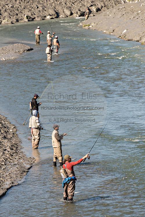 Fishermen catching salmon on Ship Creek in downtown Anchorage, Alaska.