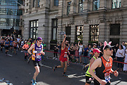Participants taking part in the London Marathon on 22nd April 2018 in London, England, United Kingdom. The London Marathon, presently known through sponsorship as the Virgin Money London Marathon, is a long-distance running event. The event was first run in 1981 and has been held in the spring of every year since. The race is mainly known for ebing a public race where ordinary people can challenge themsleves while raising great amounts of money for various charities.