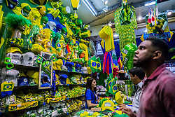 June 14, 2018 - SãO Paulo, São Paulo, Brazil - SAO PAULO SP, SP 14/06/2018 BRAZIL-SAO PAULO-WORLD CUP:Pedestrians and traffic pass on a street decorated in Brazilian flags ahead of the FIFA World Cup games in downtown Sao Paulo, Brazil, onThrusday, June 14, 2018. In a curious quirk of Brazil's electoral calendar, for the last 28 years Latin America's largest economy has gone to the polls shortly after the World Cup. In the football-obsessed country, politicians have long attempted to hijack the sport to burnish their image. (Credit Image: © Cris Faga via ZUMA Wire)