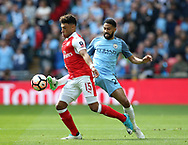 Arsenal's Alex Oxlade-Chamberlain tussles with Manchester City's Gael Clichy during the FA Cup Semi Final match at Wembley Stadium, London. Picture date: April 23rd, 2017. Pic credit should read: David Klein/Sportimage