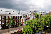 City view with typical dutch houses on the foreground, The Hague, Netherlands.Uitzicht vanaf Houtzagerssingel naar Buitenom, Den Haag