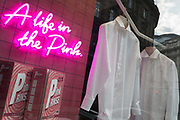 With the Coronavirus lockdown continuing into the Bank Holiday weekend, when Prime Minister Boris Johnson is due to tell the nation that only a gradual easing of regulations and social distancing rules are still to be in place, two high-quality shirts hang in the window of a menswear outfitters in a deserted City of London, the capitals financial district, on 7th May 2020, in London, England.