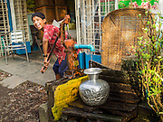 10 NOVEMBER 2014 - SITTWE, MYANMAR: A boy draws water from a communal well in Sittwe, Myanmar. Most neighborhoods in Sittwe rely on well water. Sittwe is a small town in the Myanmar state of Rakhine, on the Bay of Bengal.    PHOTO BY JACK KURTZ