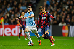 Barcelona Defender Gerard Pique (ESP) is challenged by Man City Forward Alvaro Negredo (ESP) - Photo mandatory by-line: Rogan Thomson/JMP - Tel: 07966 386802 - 18/02/2014 - SPORT - FOOTBALL - Etihad Stadium, Manchester - Manchester City v Barcelona - UEFA Champions League, Round of 16, First leg.