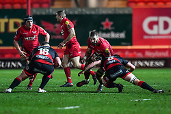 Scarlets' John Barclay is tackled by Dragons' James Benjamin<br /> <br /> Photographer Craig Thomas/Replay Images<br /> <br /> Guinness PRO14 Round 13 - Scarlets v Dragons - Friday 5th January 2018 - Parc Y Scarlets - Llanelli<br /> <br /> World Copyright © Replay Images . All rights reserved. info@replayimages.co.uk - http://replayimages.co.uk