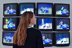 "© Licensed to London News Pictures. 31/07/2017. London, UK. A gallery staff member views ""Violent Incident"", 1986, a video played on 12 monitors, by Bruce Nauman.  Preview of the new Artist Rooms exhibition of Bruce Nauman at Tate Modern on currently until July 2018.  Nauman is widely regarded as one of the most innovative and influential American artists working today.  The Artist Rooms gallery is the London hub for showcasing work from the Artist Rooms collection which is owned jointly by Tate and the National Galleries of Scotland.  Photo credit : Stephen Chung/LNP"