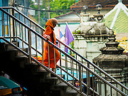 17 JULY 2015 - BANGKOK, THAILAND:     A woman walks to Ton Son Mosque in Bangkok for Eid al-Fitr services. Eid al-Fitr is also called Feast of Breaking the Fast, the Sugar Feast, Bayram (Bajram), the Sweet Festival or Hari Raya Puasa and the Lesser Eid. It is an important Muslim religious holiday that marks the end of Ramadan, the Islamic holy month of fasting. Muslims are not allowed to fast on Eid. The holiday celebrates the conclusion of the 29 or 30 days of dawn-to-sunset fasting Muslims do during the month of Ramadan. Islam is the second largest religion in Thailand. Government sources say about 5% of Thais are Muslim, many in the Muslim community say the number is closer to 10%.          PHOTO BY JACK KURTZ