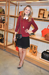 AMBER ATHERTON at a party to celebrate the launch of the Vogue Fashion's Night Out held at Mulberry, Bond Street, London on 6th September 2012.