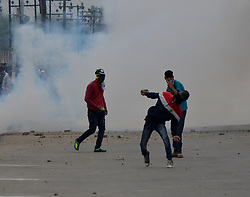 June 26, 2017 - Srinagar, Jammu and Kashmir, India - People clashed with Indian Forces after the Eid Prayers in Eid Gah, Old City, Srinagar (Credit Image: © Muzamil Mattoo/Pacific Press via ZUMA Wire)