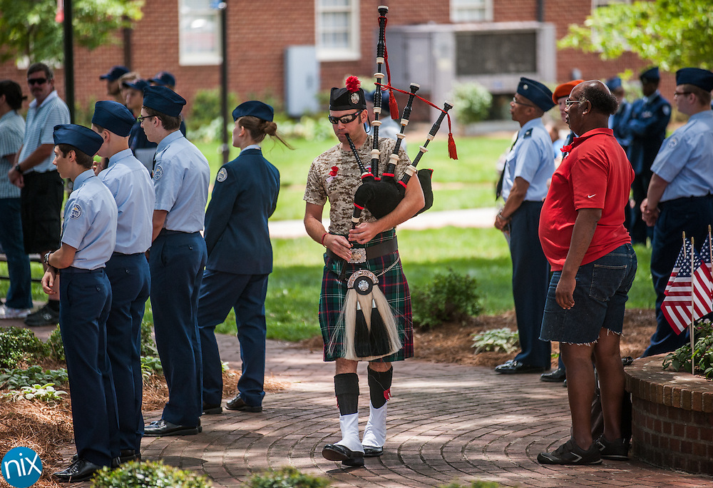"""Drew Barkley, of the Kannapolis Fire Department, performs """"Amazing Grace"""" on bagpipes during the Memorial Day Ceremony at Kannapolis Veterans Park Monday afternoon."""