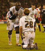 Photo: Aidan Ellis.<br /> Sheffield United v Swansea City. The FA Cup. 06/01/2007.<br /> Swansea's Adebayo Akinfenwa congratulates two goal scorer Thomas Butler after he wins a penalty
