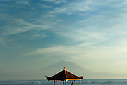 Beachside pagoda, with Bali's sacred mountain, Gunung Agung, in background, viewed from Sanur Beach at sunrise. Sanur, Bali, Indonesia.
