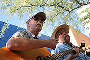 Members of Manzanita Bluegrass jam outside the Tucson Museum of Art during the 2011 Tucson Folk Festival.