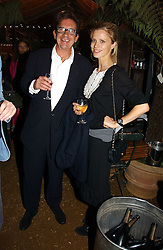 LAURA BAILEY and FRANCESCO BOGLIONE at a party to celebrate the publication on 'A Year in My Kitchen' by Skye Gyngell held at The Petersham Nurseries, Petesham, Surrey on 19th October 2006.<br /><br />NON EXCLUSIVE - WORLD RIGHTS