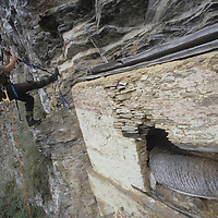 Dr. Peter Lerche examines rare unlooted pre-Incan tomb near Huabayacu River.