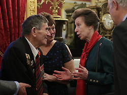 December 12, 2016 - London, United Kingdom - Image licensed to i-Images Picture Agency. 08/12/2016. London, United Kingdom. The Princess Royal with D-Day veteran Abraham Young, 93, of the Royal Engineers, during a Christmas Party at St James's Palace, London for The Not Forgotten Association - a national tri-service charity which provides entertainment, leisure and recreation for the serving wounded, injured or sick and for ex-service men and women with disabilities. Picture by ROTA / i-Images  UK OUT FOR 28 DAYS (Credit Image: © Rota/i-Images via ZUMA Wire)