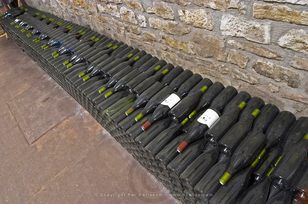 Bottles aging in the cellar. Domaine Philippe Livera, Gevrey Chambertin, Cote de Nuits, d'Or, Burgundy, France
