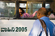 A father sees his  daughter off to school, Bangalore, India.