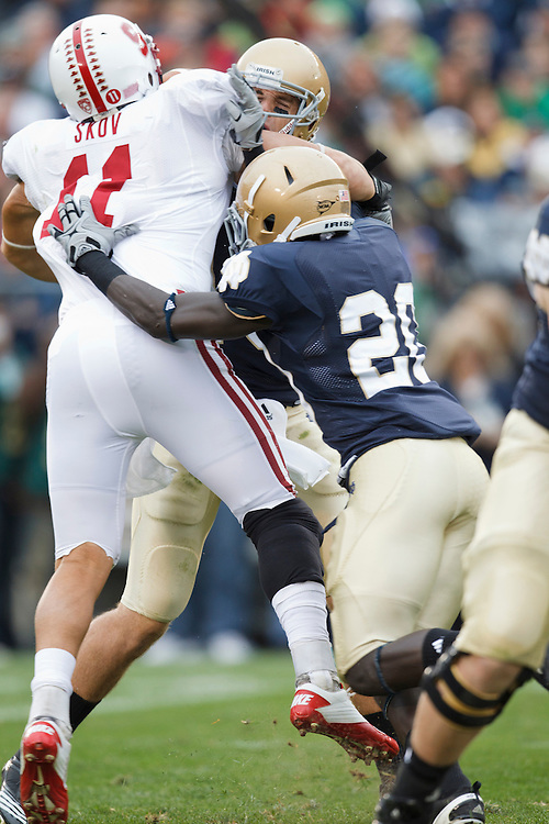 Stanford linebacker Shayne Skov (#11) sacks Notre Dame quarterback Dayne Crist (#10) during NCAA football game between Stanford and Notre Dame.  The Stanford Cardinal defeated the Notre Dame Fighting Irish 37-14 in game at Notre Dame Stadium in South Bend, Indiana.