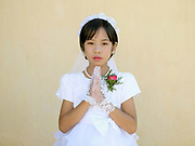 Portrait of Emily an eleven year old ethnic Kayah girl at her first communion  at Christ the King Cathedral in Loikaw, Kayah State, Myanmar on 20th November 2016. In the past most people residing in Kayah State were traditional spirit worshippers, but significant numbers have converted to Christianity, especially Baptist or Catholic