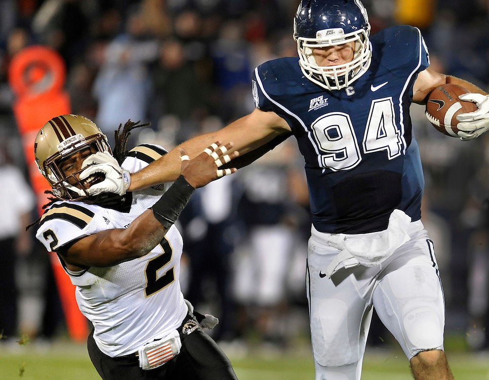 Connecticut's Ryan Griffin (94) fends off Western Michigan's Demetrius Pettway in the fourth quarter of an NCAA college football game at Rentschler Field in East Hartford, Conn., Saturday, Oct. 1, 2011.  (AP Photo/Jessica Hill)