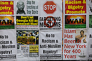 Protestor messages at September 11 Rally Against War, Racism & Islamophobia near Ground Zero on  the 10th anniversary of the 9/11 attacks on the World Trade Center towers.