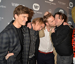 Left to right, OLIVER CHESHIRE, JAMIE CAMPBELL-BOWERS, JACK FOX and JONATHAN ROSS at the Warner Music Brit Party held at the Freemason's Hall, 60 Great Queen Street, London on 25th February 2015.
